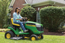 Image result for woman riding mower